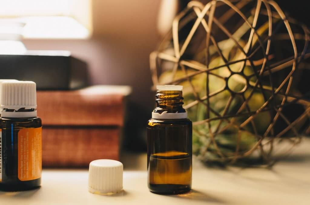Essential oils for homemade all-purpose cleaner. Photo by Kelly Sikkema on Unsplash.