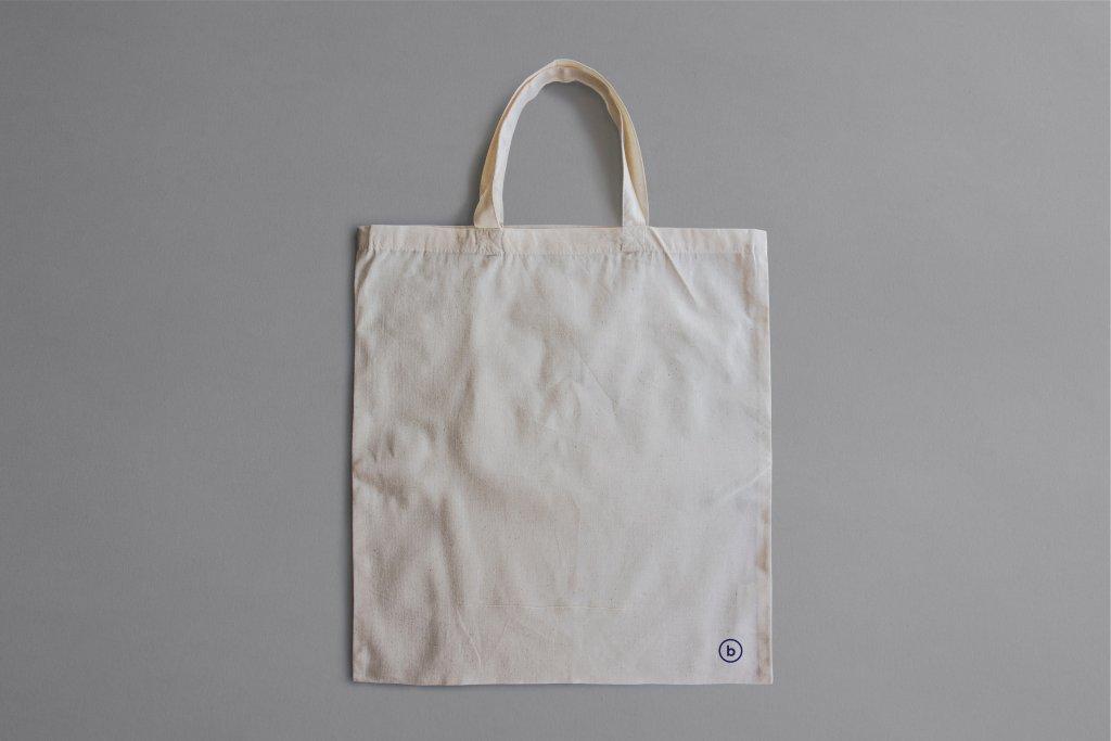 Basic tote bag. Photo by Brando Makes Branding on Unsplash.