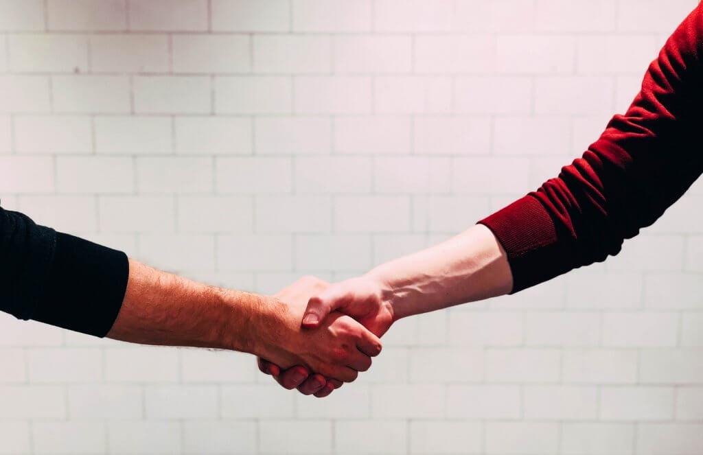 Handshake. Photo by Chris Liverani on Unsplash