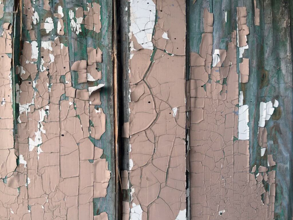 Old paint on a wooden wall.