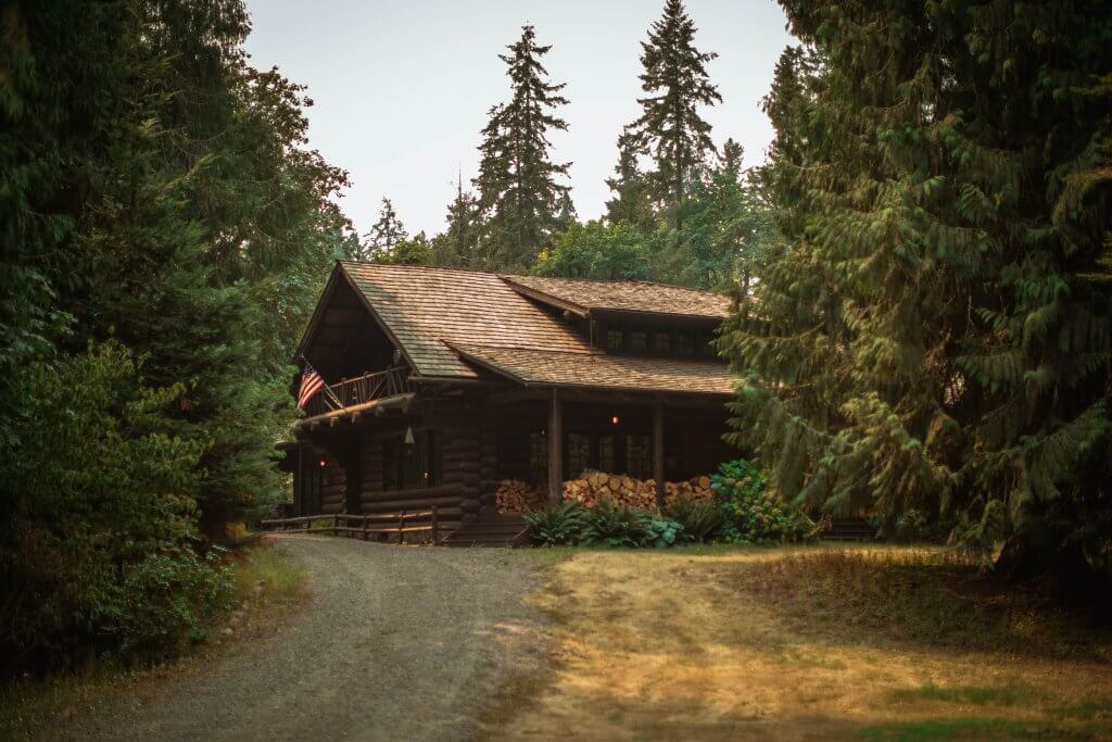 Woodland cabin. Photo by Roberto Nickson on Unsplash.