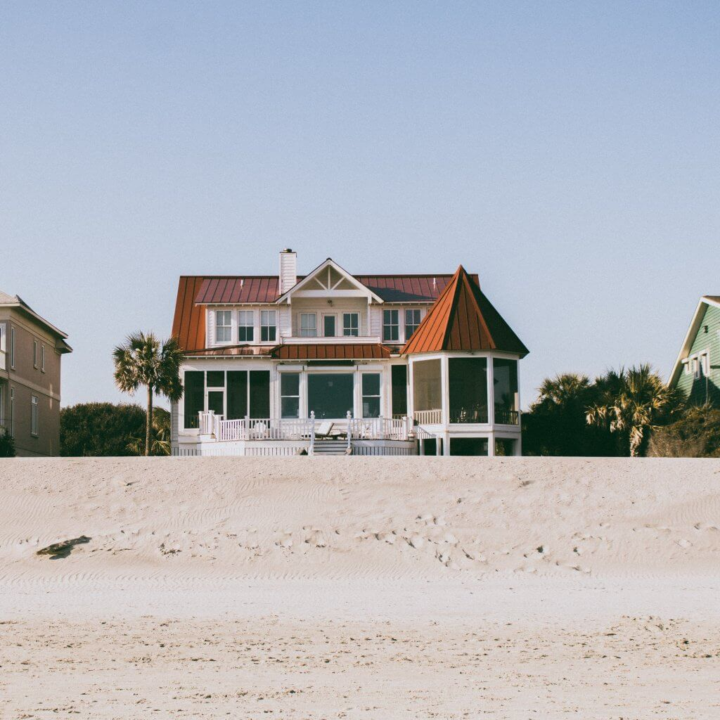 House on the beach. Photo by Tuce on Unsplash.