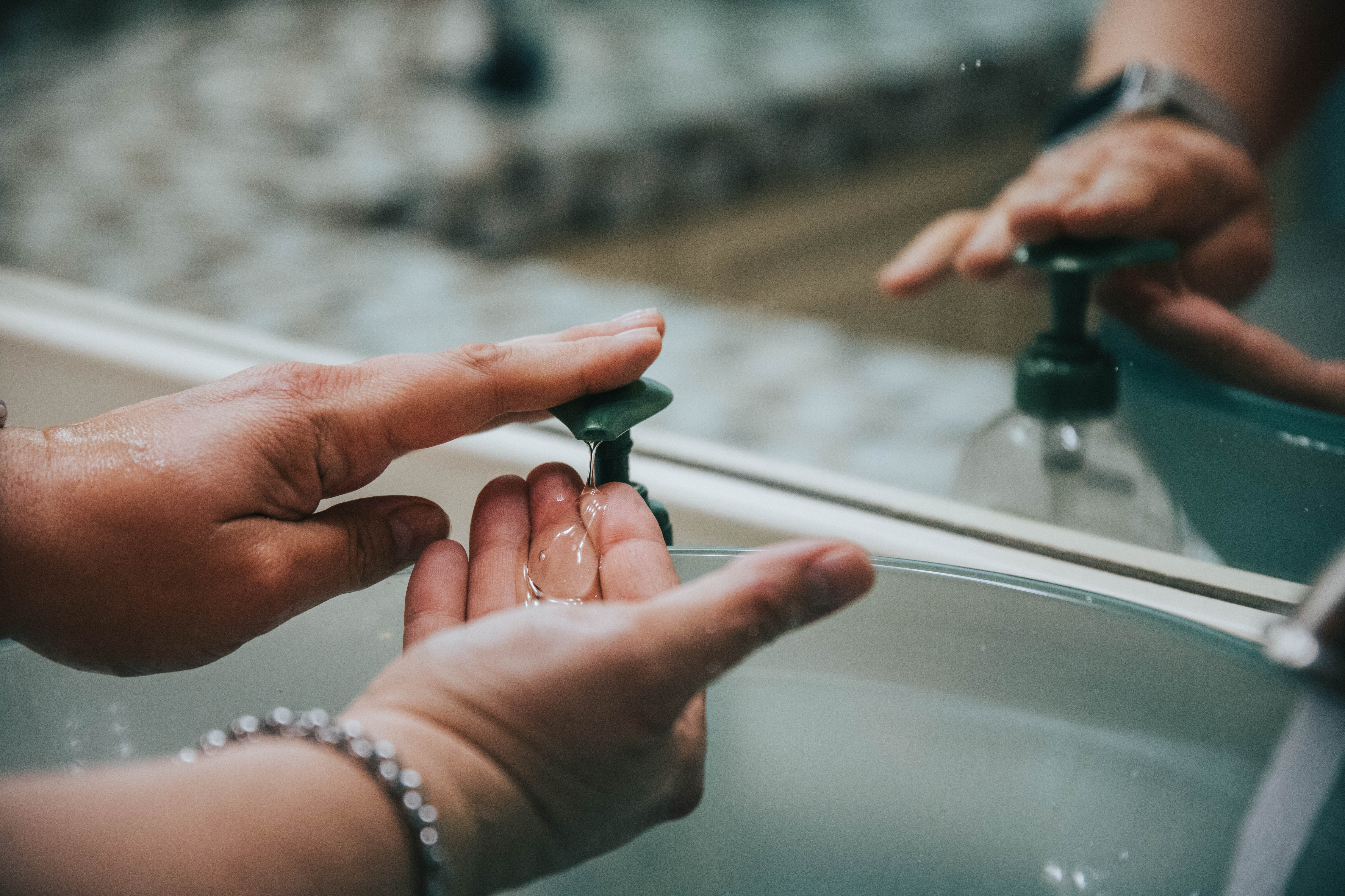 Man washing hands. Photo by Jason Jarrach on Unsplash.