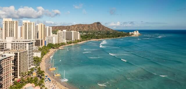 Waikiki Beach and strip. Photo by AussieActive on Unsplash.