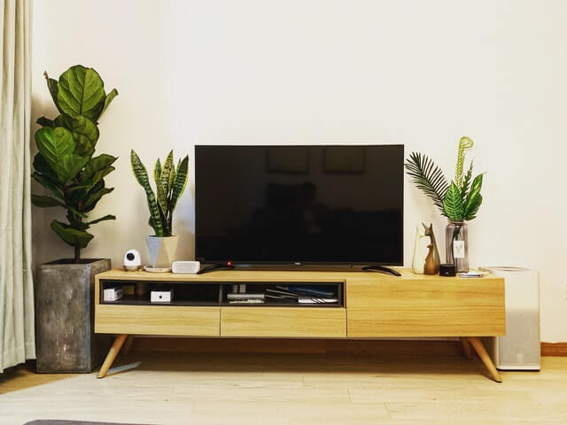 TV and entertainment center. Photo by Wang John on Unsplash.